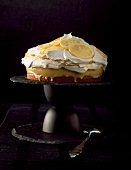 A lemon tart topped with cream