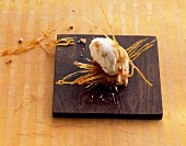 Lemon ice cream with caramel strands on a walnut cake