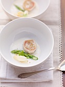 Asparagus soup with chocon de lait roulade and sauerkraut