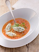Tomato soup with cheese and herb dumplings