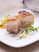 Crispy roast pork with garlic cream and a radish medley