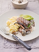 Venison escalope with a creamy morel mushroom sauce, leek and tagliatelle