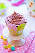 A pink frosted cupcake for kids