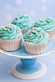 Cupcakes with turquoise frosting a sugar sprinkles