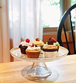 Assorted Homemade Cupcakes on a Pedestal Dish; On a Table