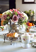 Breakfast Table with Flower Centerpiece and Silver Serving Dishes