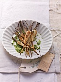 Fried root vegetables with green sauce