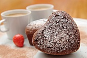 A small heart-shaped chocolate cake