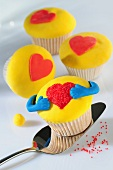 Yellow cupcakes decorated with hearts
