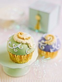 Cupcakes with green and purple icing
