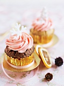 Christmas chocolate cupcakes decorated with pink buttercream and snowflakes