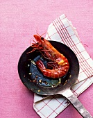 A fried king prawn with garlic