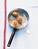 Fried potato dumplings in a pan