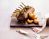 Saddle of lamb with an almond and herb crust and peaches