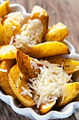 Potato wedges with mayonnaise and Parmesan