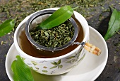 Ramson tea with a tea strainer