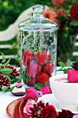 Fresh strawberries in a tall jar