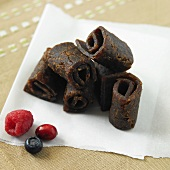 Organic Mixed Berry Fruit Leather on Paper with Fresh Berries