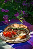 Muffalata sandwich with cherry tomatoes