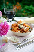 Rigatoni with tomatoes and basil, topped with melted cheese