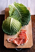Savoy cabbage leaves and Parma ham