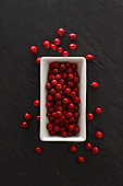 Lingonberries in a dish and on a slate platter