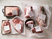 Various cuts of pork and lamb with labels