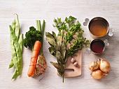 Various soup ingredients (vegetables, herbs, stock)