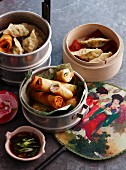 Spring rolls with salmon and wontons filled with scallops