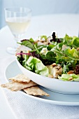 Grilled Chicken Salad with Mixed Greens, Caesar Dressing, Glass of White Wine and Crackers