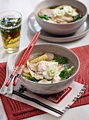 Vegetable soup with cellophane noodles and poached chicken breast
