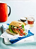 Cajun-spiced chicken burgers with salsa and avocado