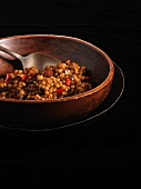 Wheat Berry Salad in a Wooden Bowl with a Spoon