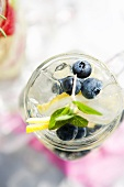Blueberries, Lemon and Mint in a Mason Jar with Soda and Ice; From Above