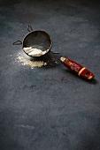 Flour in an old sieve