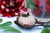 A cream cake of a marzipan rose