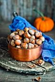Hazelnuts in a copper pot