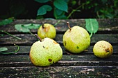 Pears on a weathered wooden table