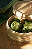 Cod and coconut pies in a bamboo steamer (Asia)