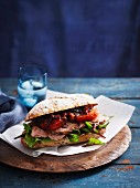 An oven-roasted tomato and beef steak sandwich