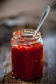 A jar of jam with a spoon
