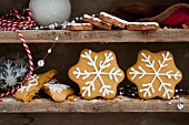 Gingerbread stars on a wooden shelf for Christmas