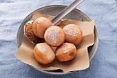 Jam doughnuts in a bowl