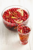Punch with rum, beer, cranberries, redcurrants and lemon