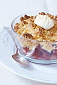 Peach crumble with creme fraiche and grated tonka beans