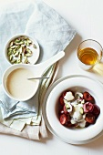 Wine foam cream with cherries and pistachios