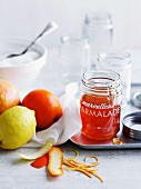 A jar of marmalade with lemons and grapefruit