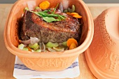 Roast beef in a terracotta pot