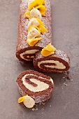Chocolate roulade filled with mango cream