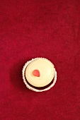 A Red Velvet Cupcake with One Pink Frosting Petal; From Above